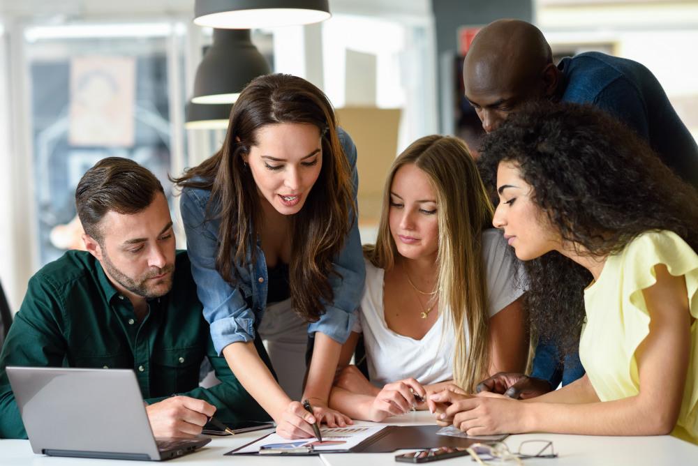 group-young-men-women-working-indoors